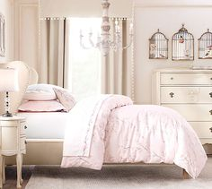 I like it-so sue me! :-) Light pink comforter to add with the beige coloured walls..bird cages..a feminine boudoir!