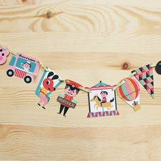 Brighten up any festive season with this garland by Swedish illustrator – Ingela P. Arrhenius. Great for decorating your Christmas tree! http://thelittledromstore.bigcartel.com/product/amusement-park-garland-by-ingela