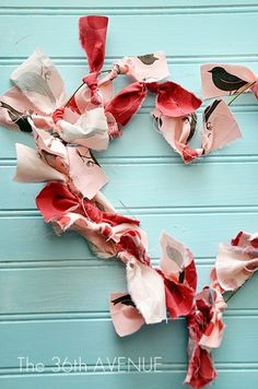 Check out this Heart Wreath Tutorial by the36thavenue.com It is made with a hanger and fabric scraps!