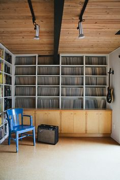 And next to the books, a wall just for the vinyl collection...