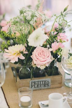 We love these gorgeous pink and cream countryside inspired flowers in vintage pallets - for more pictures of Danielle and Jordan's real-life late summer wedding with beautiful rustic touches, click here! #weddingideas