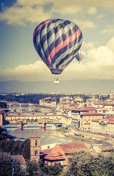 Hot air balloon over a city