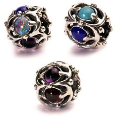 206426-51713-Trollbeads Wisdom - Five precious stones that together symbolize wisdom. An opal for loyalty, an amethyst for peace of mind, a garnet for devotion and grace, a turquoise for courage and success and a lapis lazuli for competence.