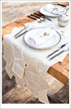 i love this idea of novel pages for a runner for your table. especially if your a writer or having a book themed wedding. you could do the exact same thing with sheet music. comments/walkingonsunshine:)