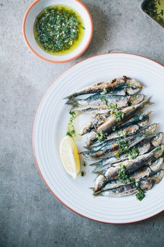 Grilled sardines with lemon, parsley and garlic. We just had this for lunch and it was so good! Literally made in 15 minutes, easy and so yummy! | jernejkitchen.com