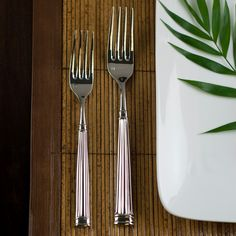 Fluted lines along the handle give a classical feel to this elegant table setting, adding a textural element to its sculpted design. Fortessa flatware embodies a passion for design combined with a commitment to the finest materials. Made from heavy-gauge 18/10 stainless steel (the heaviest gauge used for tableware), each implement provides a comfortable heft and balance in your hand. Set contains: Salad/dessert fork, table fork, table knife, dessert/oval soup spoon, tea/coffee spoon.