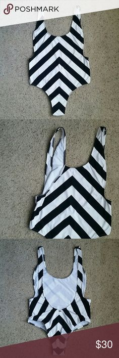 NWOT Rip Curl Le Surf Striped One Piece - L/XL New without tags, still has hygienic liner. I've had many rip curl swim suits and I've always found that they run small. The size is XL, but I would feel safer saying its at least a large. They're is no padding or lining. Cheeky bottom and low back/arm holes. Photos courtesy of Nordstrom/Rip Curl. Rip Curl Swim One Pieces