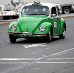 VW Beetle Taxi.. this surely must be in Mexico, one of the Beetles (Volkswagen) last manufacturing sites....