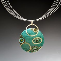 Meisha Barbee - Polymer Clay >>I love the way she integrated the bail into the bead. I love the multiple, bare wire strands!