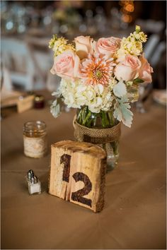 raw wood table number | peach floral centerpiece | diy barn wedding | peach wedding | #weddingchicks