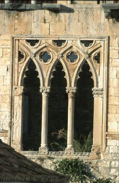 This Gothic architectural window depicts the bar tracery and the mullions for the glass panes included. These were created using individual stones, which were placed together instead of being pierced. Later forms of tracery involved leaf-shapes (foils) and began as decorative supports for the arches. The quatrefoil can be seen here and is common in Moorish culture as well. brotherbangun.net
