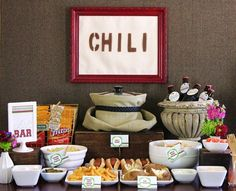 Chili Bar - make one big pot of chili and provide base items (hot dogs, fritos, baked potatoes, ect) and topping (cheese, sour cream, onion, jalapenos ect) for fun easy party food. GREAT idea!!