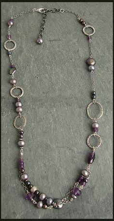 Looks like amethyst, freshwater pearls, and silver links.