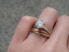 The engagement ring might be a bit blingy - but I like that the wedding band is a trinity ring