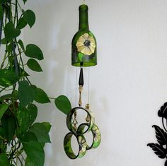 Wine bottle windchime, Amber wind chime, Golden brown and Yellow flowers, yard art, recycled bottle wind chime, hand painted chime by LindasYardArt on Etsy