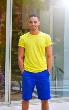Shop this look for $57:  http://lookastic.com/men/looks/yellow-crew-neck-t-shirt-and-blue-shorts/1507  — Yellow Crew-neck T-shirt  — Blue Shorts