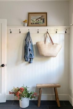 Cottage mudroom boasting a beadboard trim wall with oil rubbed bronze hooks and a wooden stool next to a potted plant on charcoal gray floor tiles. Grey Floor Tiles, Gray Floor, Wooden Trim, Bead Board Walls, Home Board, Design Shop, House Design, Shop Interiors, Home Renovation