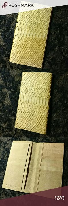 "Python Skin Bifold Wallet In wonderful condition.  The inside feels like lambskin. It's very soft and supple.  The outside snakeskin is soft and not cracking or peeling.  The wallet says   ""Donna Karan New York.   Genuine Python  Made In Italy""   but I cannot verify its authenticity. It is definitely real Python, though.  Measures 6.75"" by 4.74"" when closed. DKNY Bags Wallets"