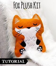"""Tutorials   Urban Threads: Dream big with this unique fox plush kit! Your download includes a simple pdf template, and then all the embroidered little accents you need to create this giant 15"""" plush fox pillow."""