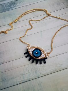 Evil eye beaded necklace Blue eye necklace Trendy jewelry Embroidered necklace Gift for women Fashion necklace for your bright image. The work uses Czech beads, pearl beads, leather and fittings. Recommendations for care: Do not wet. Length 21 inches (54 cm) Attention!!! Dear customers, I ask you