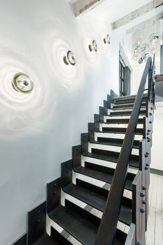 Pressed Glass Wall Lights by Tom Dixon light the stairway of the Metropolitan Wharf Penhouse