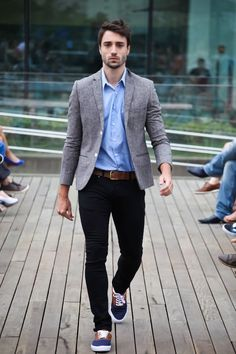 Dress in a grey wool blazer and black skinny jeans to achieve a dressy but not too dressy look. Feeling brave? Complete your look with navy canvas plimsolls. Shop this look on Lookastic: https://lookastic.com/men/looks/blazer-long-sleeve-shirt-skinny-jeans/9474 — Light Blue Long Sleeve Shirt — Grey Wool Blazer — Brown Leather Belt — Black Skinny Jeans — Navy Canvas Plimsolls