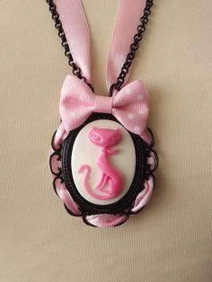 Pink cat in white cameo pendant necklace by ClaudiaCandeiasArt, €12.00