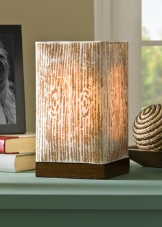 Use new Mod Podge Rocks stencils to decorate a lamp with a woodgrain pattern! This would fit into a variety of decor styles.