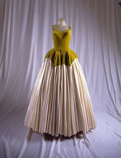 The petal ball gown, a variant on a dress first made for Millicent Rogers in 1949, is typical of James's interst in deriving designs from nature, at least purportedly, with such biomorphic forms and names in preparatory sketches, including the tree, butterfly, swan, and clover-leaf