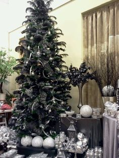 Maybe a black Christmas tree for Edward Scissorhand themed Christmas... or white but black because it shows the snow more....oooo I should find a black and white tree.
