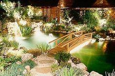Wood garden bridge on pinterest bridges garden bridge for Wooden koi pool