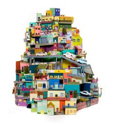 A cardboard city made from recycled cards and photographs by Ana Serrano. Amazing!