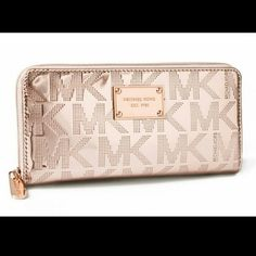 MK Rose Gold Continental Mirror Metallic Wallet Purchased and been sitting in my closet ever since.  Wrapped in rose gold mirrored metallic PVC with MK block lettering all around and rose gold hardware. The front is accented with Michael Kors logo name plate.  Zip around style wallet features 8 credit card slots, a zippered coin compartment and full length bill compartments.   Length ~ 8 1/4 in. Height ~ 4 1/4 in.  No dust bag/box. Didn't come with it.  No trades PRICE FIRM, I am not making…