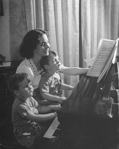 Jennifer Jones, at home playing the piano with her sons Robert Jr. and Michael...1940s