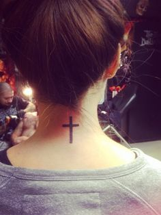 Cross back of the neck. It's really simple. Like it. My third tattoo.