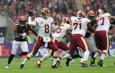 Redskins vs. Bengals:      October 30, 2016  -  TIE: 27-27  -     Kirk Cousins passes the ball downfield during the 2nd quarter. (AP Photo/Matt Dunham)