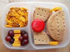 On Nature's Own Whole Wheat Rounds - a turkey and cheese sandwich and PB Also in the large compartment is a Babybel.  Some cheddar cheese chunks and red seedless grapes, Annie's cheddar bunny snack mix. Lots more here: http://easybentos.blogspot.com