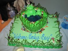 Frog Pond Baby Shower Cake - My niece was having a baby boy and totally loves frogs, I knew she was planning on decorating the nursery in frog theme.  Which there for gave me the idea for a frog pond cake.  French Vanilla cake, butter cream icing, blue jello for pond, green licorice for grass, raisins on toothpicks for cat tails, and my favorite (which my hubby found and picked up for me) edible pond stones. =)  Was a hit and everyone loved it!