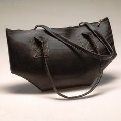 High fashion meets trash—literally. This stylish Urban Tote from Rac Sacks is made from recycled tire inner tubes for a look that's sophisticated and edgy. This fashionable workhorse is fully lined with cell phone pockets and a top zipper.