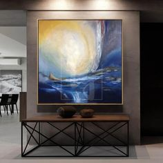 TWO ELEMENTS This painting is inspired by the sunrise over the ocean. Imagine sunbeams reflect in the sea waves and light up the sky. It is a time of two elements awakening and time to remind ourselves that following the dark night always comes light.The artist depicted the ocean in deep blue, navy and indigo colors. H