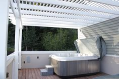 Take a look at this beautiful rooftop patio! What a peaceful place to enjoy yourself under shady cover from this traditional Potomac pergola kit. The custom design and column mount allow for added amenities like a hot tub and dining set without obstructing views or overtaking useable square footage. Immersing oneself into nature is too easy at these heights. This low-maintenance shade structure is supported by five 5″ vinyl columns, double beams and traditional decorative end detail.
