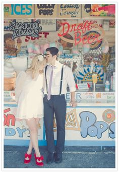 Not a fan of the bride, but love the grooms look. And the carnival background.