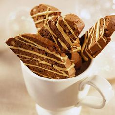 """Mocha Biscotti An espresso drizzle adds a hint of coffee flavor to these crisp cookies. Biscotti means """"twice baked"""" in Italian. Mocha Biscotti 12345 Prep: 30 mins Cool: 1 hr Bake: 35 mins degrees F save this recipe See Mocha Biscotti recipe Italian Cookies, Italian Desserts, Just Desserts, Delicious Desserts, Yummy Food, Biscotti Cookies, Biscotti Recipe, Biscotti Biscuits, Bar Cookies"""
