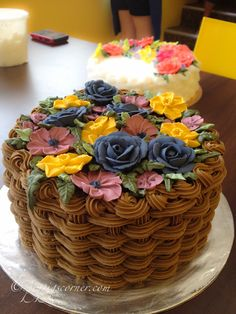 Wilton Method of Cake Decorating Course 2 basketweave flower cake