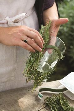 Find out how to turn jars into beautiful flower vases with Sarah Raven's guide to creating a unique table centrepiece.