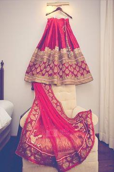 Gorgeous red lehenga with banaras butta, zari ,lace border and net dupatta with Zari the border.