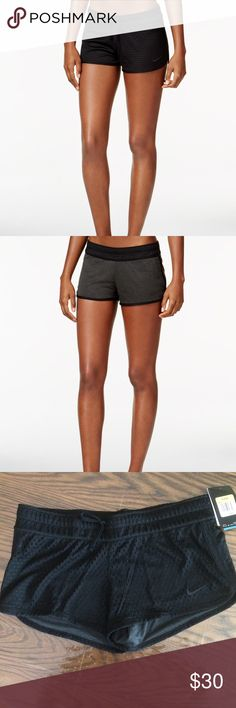 """Nike Reversible Dri Fit Training Shorts Polyester. Machine washable. Mid rise. Slim fit through hips and thigh. Pull on styling. Elastic waistband with drawstring. Dri Fit helps keep you comfortable. Jersey fabric on one side mesh on other. Approx inseam 2 1/2"""" Nike Shorts"""