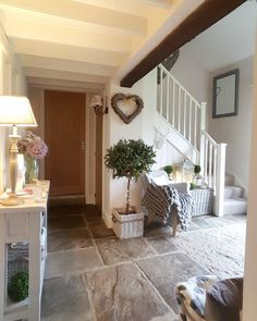 stone flooring Country home . modern country hallway Stone floor Faux bay tree Hearts Throws Country home . Tiled Hallway, Modern Hallway, Modern Cottage, Modern Country, Cottage Hallway, Foyer Flooring, Salons Cosy, Flagstone Flooring, Hallway Designs
