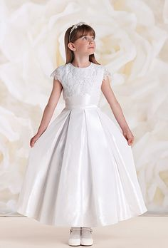 First Communion dresses in the Joan Calabrese Collection by Mon Cheri are available in ball gown, fit and flare, or A-line dress styles. Featuring traditional white dresses with sleeveless or short-sleeved options. Ivory Flower Girl Dresses, Wedding Dresses For Girls, Little Girl Dresses, Lace Dress, Girls Dresses, Dressy Dresses, Cute Dresses, Girls Communion Dresses, White Ball Gowns