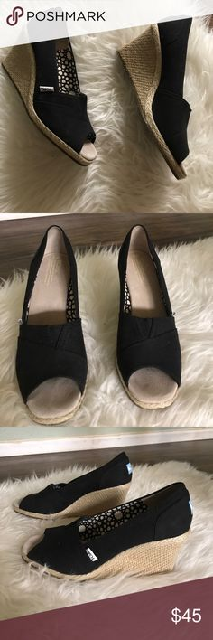 TOMS wedges Adorable TOMS wedges. Black canvas with open toes. EXCELLENT condition. Wedge height 3. Toms Shoes Wedges